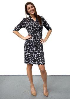https://cdn.shopify.com/s/files/1/1153/2270/products/shopgirls-press-wrap-dress-w-elbow-sleeve-front_1024x1024.jpg?v=1484263791