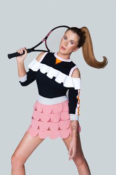 Looking ready for tennis, Ireland Baldwin models Red Valentino skirt and No Ka' Oi top