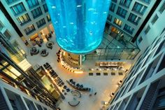 The huge cylindrical aquarium in the atrium of the Berlin hotel