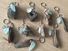 A beautiful hand selected piece of Isle of Wight driftwood and beautiful sea glass alongside a mini silver charm go into making this one of a kind keychain It is a completely natural piece of driftwood which was found on the shores of the Isle of Wight. Approximate size of key ring is