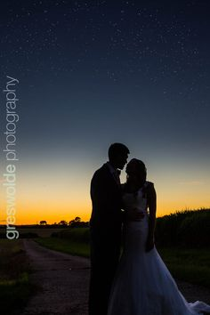Bride and groom silhouette portrait under the stars