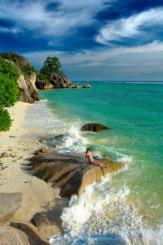 Beautiful seascape in La Digue Island, Seychelles/••••seems like this place has beautiful beaches, but is not well populated. What about making reservations for a bungalow or a cabana room - much less, DINNER??!!!/
