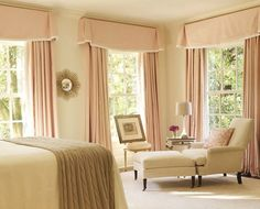 This master bedroom lights up with pale pink window treatments by the one and only Suzanne Kasler.