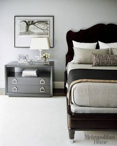 Designer Lori Graham  turns this bedroom into a retreat that is equal parts baroque and Bauhaus. The bed has a Chippendale-style headboard that is detailed with chrome-finish stainless steel and paired with planar nightstands in a matching deep texture.   - ELLEDecor.com