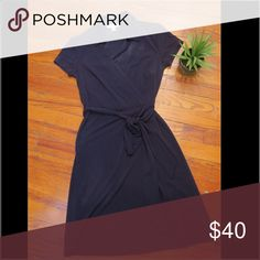 Navy Blue Wrap Dress Cute and comfortable navy wrap dress worn a few times. No damage. Good condition. Kenar Dresses