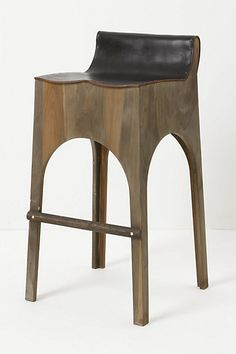Ellery Barstool / Handcrafted from deep chestnut-hued sycamore and a sturdy sheet of leather / by Philadelphia-based artist Robert Ogden of Lostine