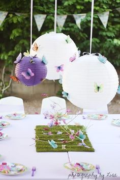 Add butterflies to branches and paper lanterns for a whimsical birthday party!  Pinned by Afloral.com.  Afloral.com has high-quality flowers and decorations #afloral #weddings #birthdays #lanterns #diy #crafts