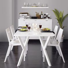 66' dining table. $329. http://www.crateandbarrel.com/dining-and-entertaining/dining-kitchen-tables/ypsilon-66-rectangular-dining-table/s667024