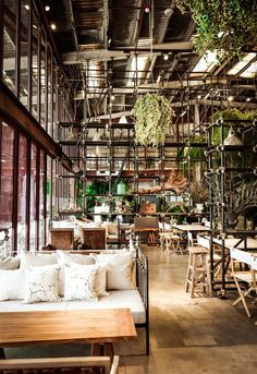 Hypothesis, a Thai design agency, transformed this old warehouse into a modern, 'green' restaurant.