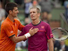 Novak Djokovic at the net with Jarkko Nieminen after their match on day three at Roland Garros.  Susan Mullane, USA TODAY Sports