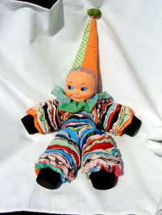 Handsewn Quilted Yo Yo Cloth Clown Doll,  Dunce Hat, Collectible Toy. $14.95, via Etsy.