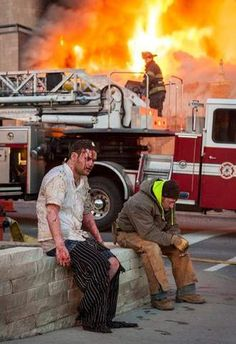 Chef Patrick Woodward sits in a bloodied daze after gas explosion at J.J's restaurant.  Kansas City. Feb 19, 2013.  Photo by Bob Greenspan