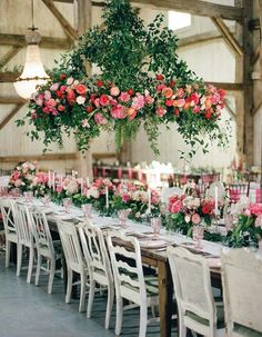 This year we're embracing the hanging floral obsession with gorgeous, floral-encrusted chandeliers for this year's brides.