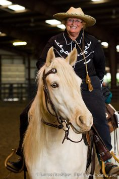 Missouri Fox Trotter, Powder, is a gold cream champagne daughter of JJ.  This is me riding her in a 2013'horse show.  She is currently competing in Ranch Horse and Versatility events with Caitlyn Vaught in 2014.