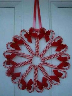 Didn't see instructions but looks easy peasy - candy canes + ribbon + hot glue = darling wreath. :) I think I might like to do little green ribbons instead of the red? Candy cane wreath-what to do with the candy canes you DON'T want your kids to eat! Dollar Store Christmas, Christmas Candy, Homemade Christmas, Diy Christmas Gifts, Simple Christmas, Christmas Projects, Christmas Holidays, Christmas Decorations, Christmas Ornaments