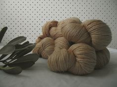 This yarn is naturally dyed using Brown Onion Skins. The Colour may evolve with wash, wear and handle.Spinning a Yarn yarn consists of Silk and Merino in a custom made twist - which mea. Spinning, Onion, Handle, Throw Pillows, Colour, Silk, Brown, Hand Spinning, Color