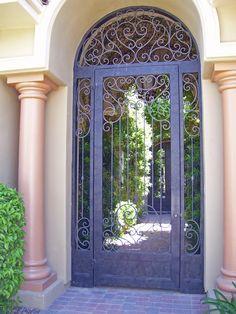 a beautiful door with ornamental iron design ...