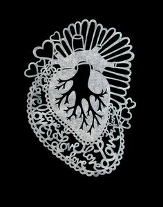 """""""Sacred Heart"""" designed and painstakingly cut out by my wife from a single sheet of paper using an Xacto blade."""