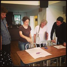 Director, Kira Simring reviewing the ground plan with the cast of The McGowan Trilogy. The play, by Seamus Scanlon, opens for a limited engagement on Sept 11, 2014. At the cell theater, New York City. http://www.thecelltheatre.org/events/2014/9/11/the-mcgowan-trilogy-7-pm