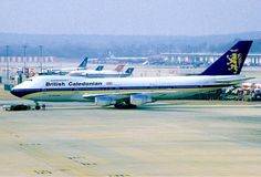 "British Caledonian Airways Boeing 747-2D3BM G-HUGE ""Andrew Carnegie - The Scottish-American Philanthropist"" on a hazy day at London-Gatwick, March 1986. (Photo: Tim Rees)"