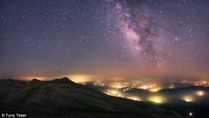 Sky away from the Lights, taken with a Hutech modified Canon 5D camera. Like an alien landscape, pools of hazy light stretch into the distance of this photograph taken near Bursa in Turkey