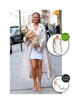 Chrissy Teigen carrying her pup around New York - seen in Stuart Weitzman. #stuartweitzman  #chrissyteigen @dejamoda