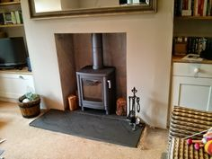 Contura in grey installed on riven slate hearth. We rendered the fireplace with lime render. Log Burner Living Room, Slate Hearth, Long Room, Wood Burner, Living Room Inspiration, Ideal Home, Living Room Decor, Home Appliances, Interior Design