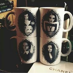 Vampira, Lilly Munster, Wednesday Addams, and Morticia Addams mugs... I NEED these..