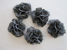 Aunt Priscilla, this is a great tutorial of how to make cute fabric flowers. We could add these to the flower girl baskets in different purple, green, and ivory fabrics. CUTE!!!