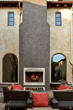 Unwind with a glass of red by the outdoor fireplace in the courtyard. #Jetsetter
