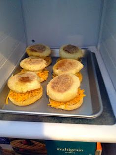 Breakfast on the go!  I might not make the whole sandwich and freeze them, but I like the idea of baking 6 eggs in a muffin tin the oven while I shower.  :)