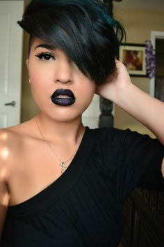 Vampy / goth... Whatever you call it, black lipstick has never looked so very beautiful as this.