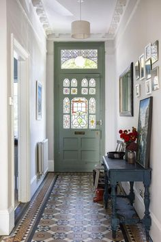 Farrow & Ball Ammonite grey on the walls and Pigeon on the front door, combined with the original Edwardian floor tiles and vintage console & mirrors make the entrance hallway of this Edwardian house in South London feel grand but welcoming. Interior Design by www.imperfectinteriors.co.uk Photos by Chris Snook #homedecorideas