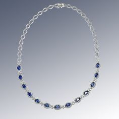 DIAMOND AND SAPPHIRE NECKLACE STYLE ID: 14857   #nycwdiamonds  Exquisite Diamond and Sapphire Necklace in 18kt white gold. Oval Shape Sapphires total carat weight 7.48cts. Round Brilliant Diamonds total carat weight 3.25cts