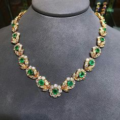 A floral motif diamond and emerald necklace made by VCA circa 1960 Convertible into two bracelets