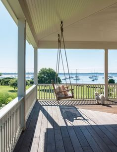 exterior - porch - deck - summer cottage - island home - new england home - seaside cottage - porch or patio furniture - porch swing - rope - sea view - ocean view - havanese - dog - wrap around porch - taste - interior design - rhode island Cottage Porch, Coastal Cottage, Cottage Homes, Coastal Style, Coastal Living, Country Living, Lake Cottage, Farmhouse Outdoor Decor, England Beaches