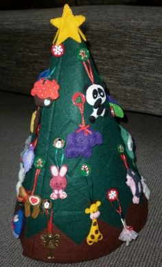 My felt Christmas tree was inspired by a beautiful one I saw on someones Pinterest board. Made from thick felt and decorated with handmade felt ornaments.