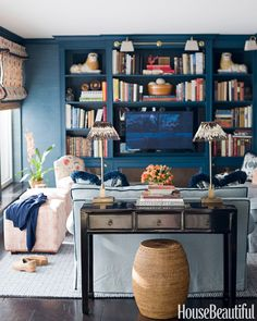 In a New York City apartment, a formal dining room was turned into a cozy library.