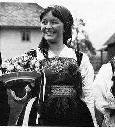 111 Girl from the Gailtal. Revived dress. The scarf pinned across the chest is typical of this valley.  - THE FOLK DRESS OF EUROPE, James Snowden, © Copyright: 1979 by James Snowden