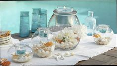 Clearly Creative Holders accented with white flowers and blue candles. Massage Place, Good Massage, Candle Accessories, Blue Candles, Centerpieces, Table Decorations, Creative Decor, Creative Ideas, White Flowers