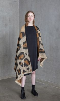 Earthy-toned scarf boldly printed with an exaggerated leopard print and edged in cream fringing. Plumo.com
