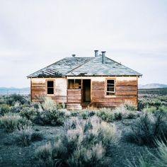 Josh Etheridge. abandoned cabin, stark landscape
