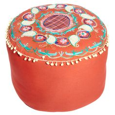 Orange cotton ottoman with an exotic floral motif and pom pom trim.  Product: OttomanConstruction Material: Cott...