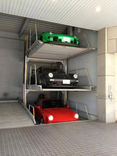 "Porsche Garage Storage. If I had 3 Porsches and a stacking system like this, they sure as hell wouldn't be in a crappy ""storage unit"" syle garage ... uuugh!"