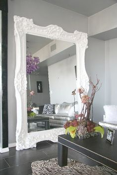 love this oversized white mirror against a gray wall!