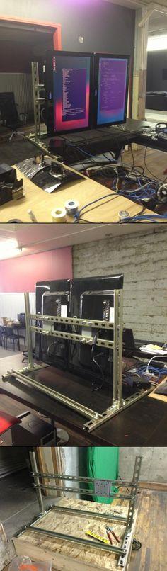 A $50 dual vertical TV mount built out of Unistrut. It's for my digital signage development setup.