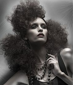 A long black curly frizzy sculptured avant garde hairstyle by Phil Smith