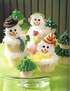 Cupcake + Powder donut = Snowman!   (I like the single cupcake one best, with fondant scarf and hat or earmuffs.)