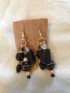 Black and gold handmade clump earrings. www.etsy.com/shops/nealycreations