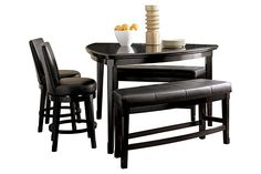 """The Emory Counter Height Dining Table from Ashley Furniture HomeStore (AFHS.com). The """"Emory"""" counter height table uses subtle curves and a rich contemporary design to create a comfortable furniture collection that is sure to enhance the atmosphere of any dining experience."""